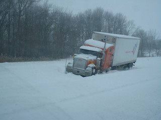 cars and trucks on the side of the road and in ditches during a blizzard | by dane brian