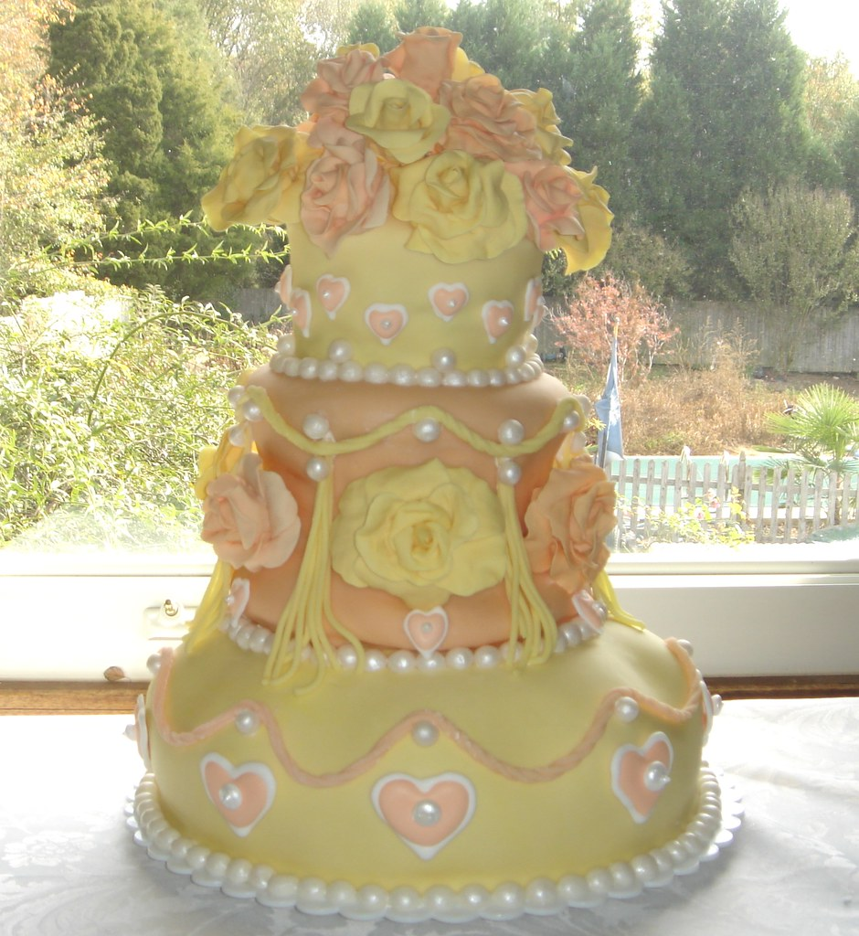 Three tier wedding cake with orange and yellow roses, suga… | Flickr