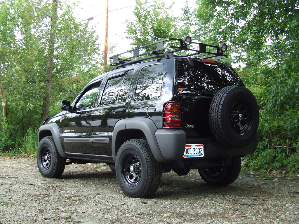 02 jeep liberty sport | -surco safari rack with 5 rubber hou… | flickr