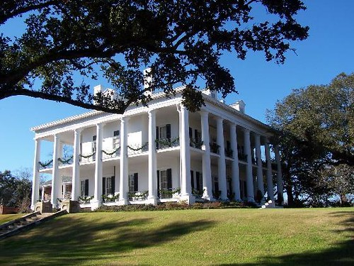 Dunleith plantation encircled by 26 stately white for New homes in mississippi