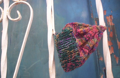 the angel hat, on the upholstery shop's ironwork | by cafemama