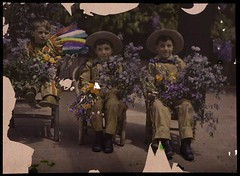 Three boys in western costumes holding flowers | by George Eastman Museum