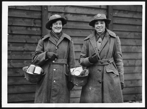 WAAC's in France find German helmets useful substitutes for market bags | by National Library of Scotland