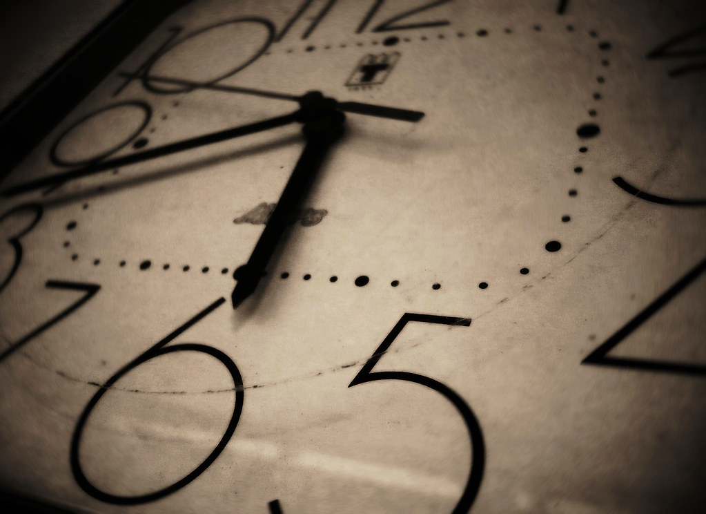 black and white image of a clock showing 5:40