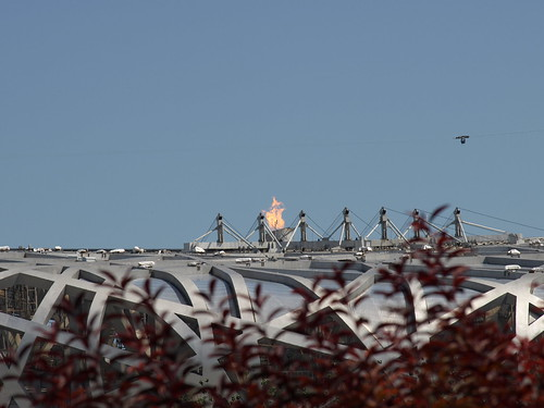 The Olympic flame on top of the Bird's Nest, the main stadium | by fastlaine