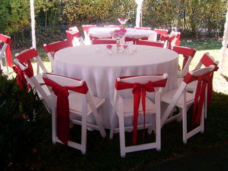 Red and white Table | White cloths with red chair ties ...