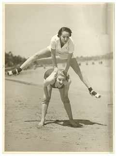 "Valerie Hays from the cast of ""Over she goes"" being leapfrogged, 1937 / by Sam Hood 