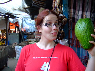At a market in Zanzibar holding a huge soursop | by jacquimaher
