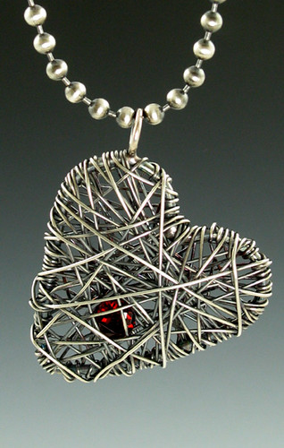 caged heart with garnet | by Michele Grady
