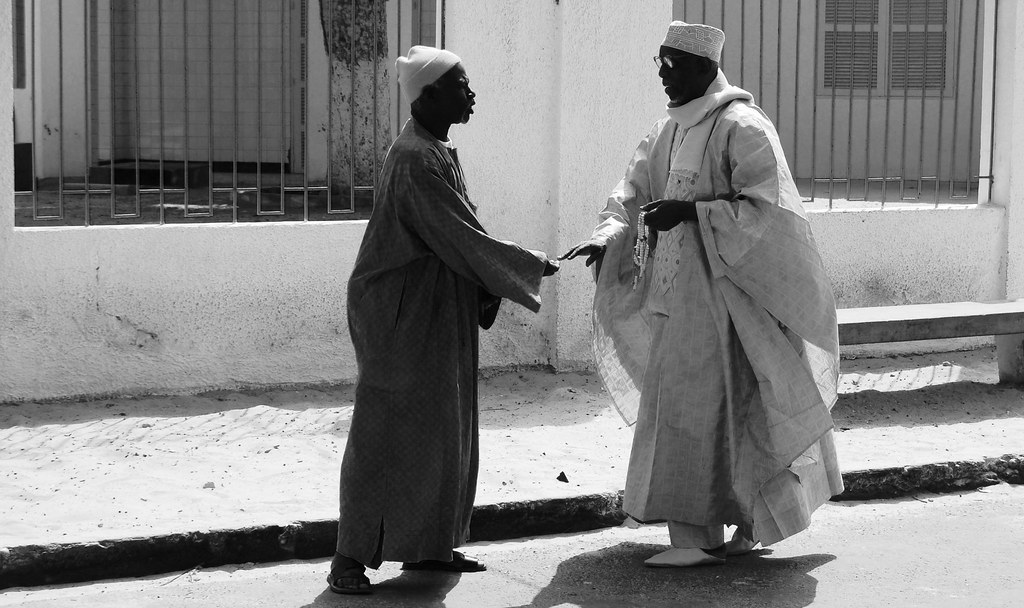 Senegalese greetings these two men greeting each other out flickr senegalese greetings by dancingamie senegalese greetings by dancingamie m4hsunfo