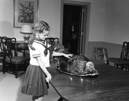 Governor Collins' daughter Darby with Thanksgiving turkey at mansion: Tallahassee, Florida | by State Library and Archives of Florida