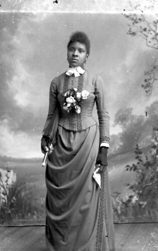 Woman holding a parasol and handkerchief | by State Library and Archives of Florida