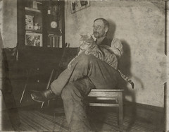Seated Man With Large Cat | by AtypicalArt