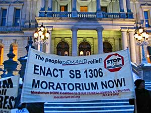 "Banner from the Moratorium Now! Coalition to Stop Foreclosures and Evictions outside the Michigan State Capital in Lansing at the Governor's ""State of the State"" address on February 3, 2009. 