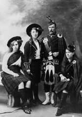 Four people in a variety of highland dress | by State Library of Queensland, Australia