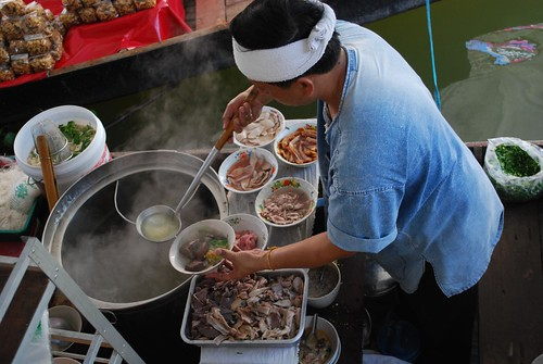 Hawker preparing pork noodles with offal - Taling Chan Floating Market | by avlxyz