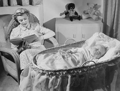 Woman reads as baby sleeps | by National Science and Media Museum
