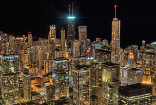 The Hancock Building beaconing over the dark city night - Chicago | by Mister Joe