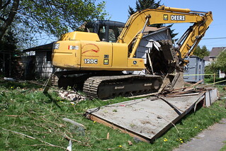 Bulldozer tearing down house | by piddix