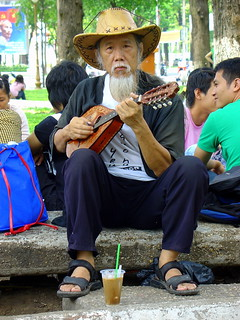 Friendly man playing Mandolin in the park near Notre Dame Cathedral, Ho Chi Minh City, Vietnam | by Eustaquio Santimano