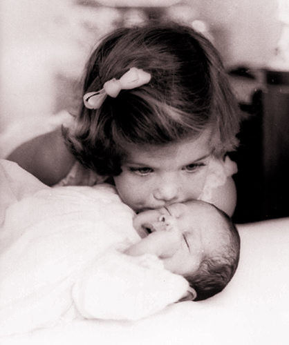Caroline Kennedy, 3, kisses her babybrother John F. Kennedy Jr. in 1961 | by thesmuggler- Night of the Swallow""