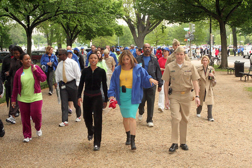 Olympic Gold Medalist Dominique Dawes, Loretta Sanchez (D-CA), Admiral John O. Agwunobi, M.D., HHS assistant secretary for health, and hundreds of federal employees walk on the Mall on National Walk at Lunch Day, April 29, 2009