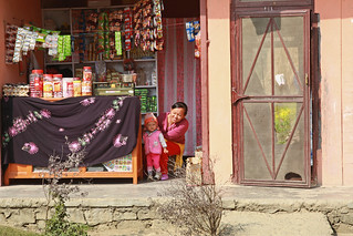 Shopkeeper and child | by World Bank Photo Collection