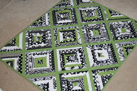 Black white green string baby quilt front by filminthefridge