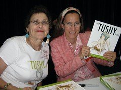 A proud author and artist  get ready to sign THE TUSHY BOOK | by publishersmarketplace