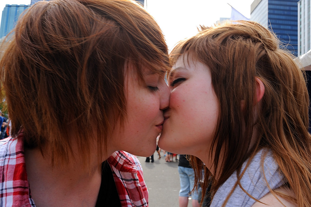 women kissing girls