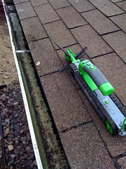 cleaning gutters with covers