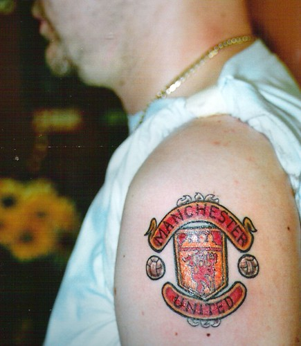 manchester united football club crest tattoo