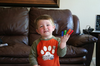 Nephew playing with marker lids | by turning*turning