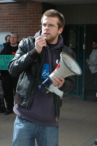 Student on megaphone | by savelinguistics