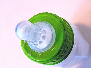bottle with green ring | by nerissa's ring
