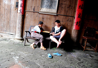 two boys playing chinese chess, xiamei village | by hopemeng