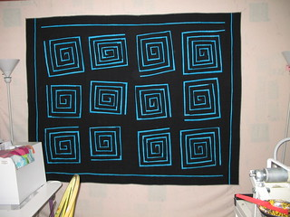 Turquoise and black spirals | by white lotus quilting