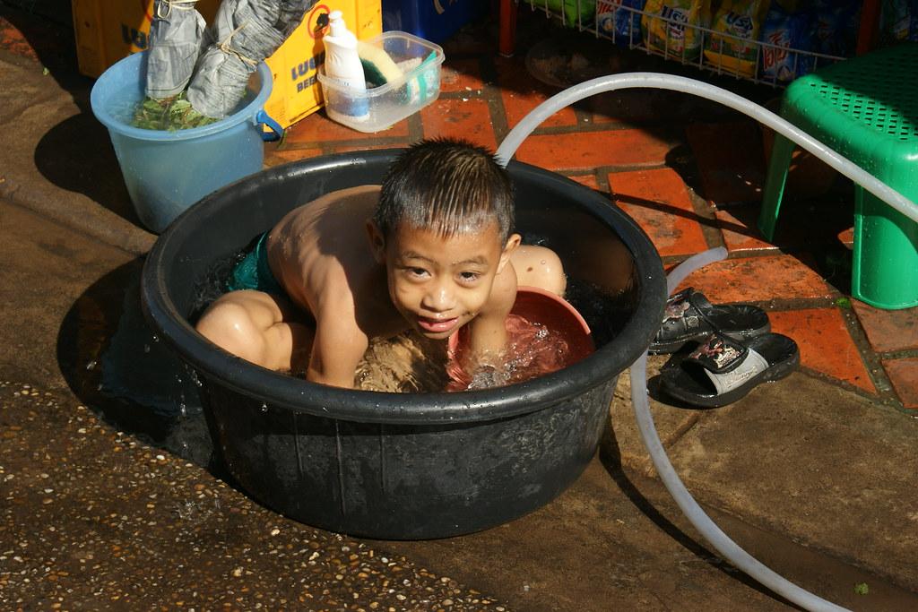 Street bath, Vientiane, Laos