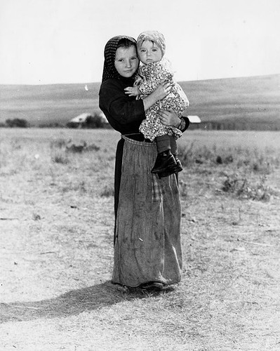 Hutterite girl holding her baby sister | by Galt Museum & Archives on The Commons