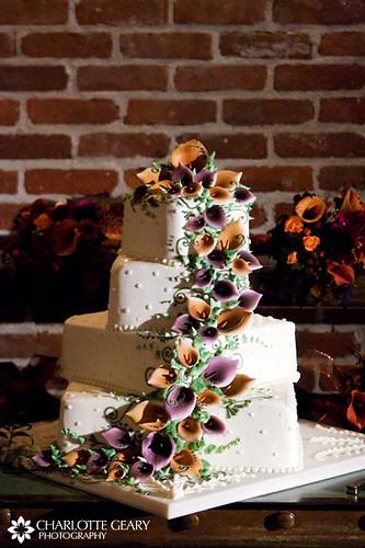 Wedding cake with orange and purple sugar calla lilies | Flickr