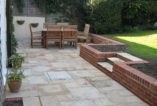 Patio With Retaining Wall Antiqued Natural Sandstone