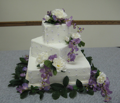 3 tier wedding cake with cascading roses three tier stacked wedding cake with cascading flowers 10341