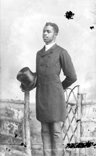 Man holding a top hat | by State Library and Archives of Florida