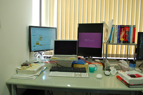 My desk. Ubuntu in the corner, MacBook Pro in the center | by Kimtaro