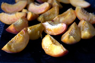 quartered and pitted peaches | by smitten kitchen