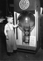 Tommy Dodgen, age 4, standing by the largest lamp in the world: Tampa, Florida | by State Library and Archives of Florida