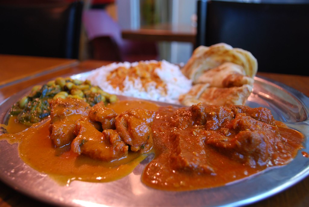 ... Goat Vindaloo, Butter Chicken, Spinach and Black Eye Beans with half rice + roti