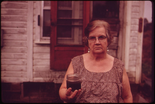 Mary Workman Holds A Jar of Undrinkable Water That Comes from Her Well, and Has Filed A Damage Suit Against the Hanna Coal Company ..., 10/1973 | by The U.S. National Archives