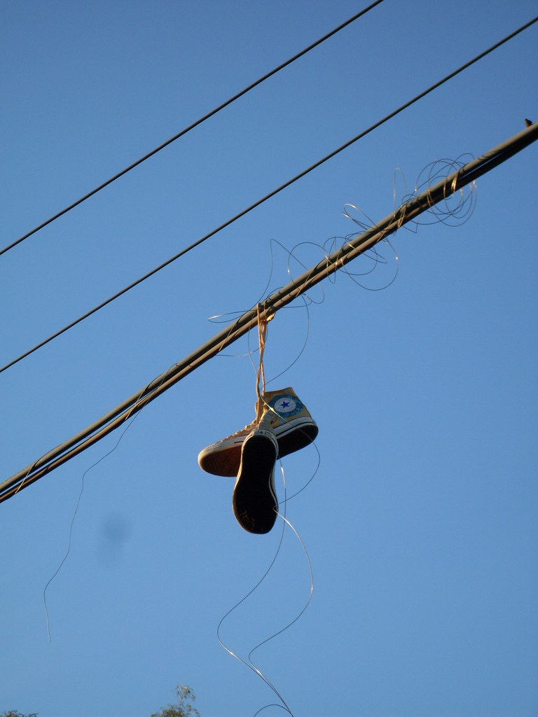 3768954422_62972d5ba0_b old converse shoes on wires what a waste of good converse flickr