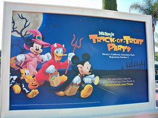 Mickey's Trick-Or-Treat Billboard in Main Entrance Plaza | by Castles, Capes & Clones